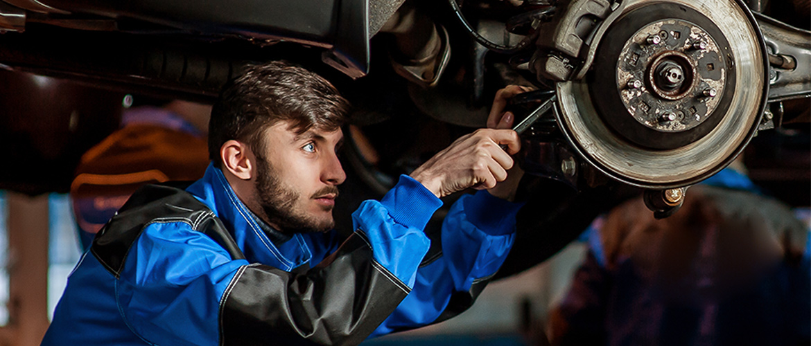 attractive mechanic working on a car
